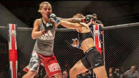 women fighting in octagon