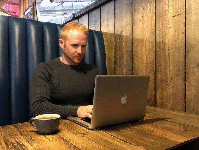 alex neilan on laptop